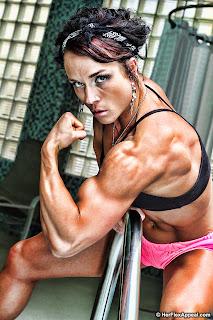 Sara Butler flexing biceps