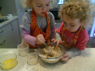 Mixing the oaty topping for the Strawberry Muffins