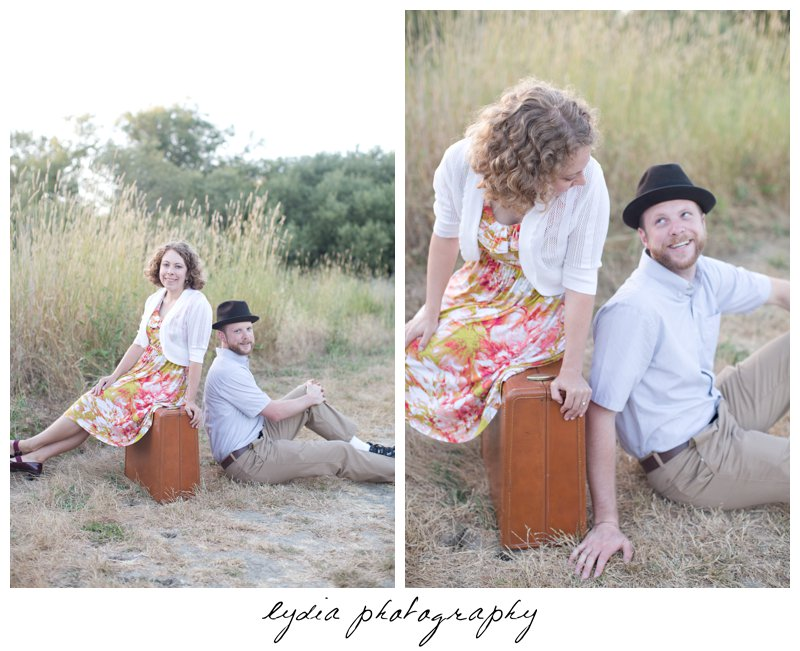 Bride sitting on the luggage and groom on the ground at lifestyle engagement portraits in the Bay Area of California