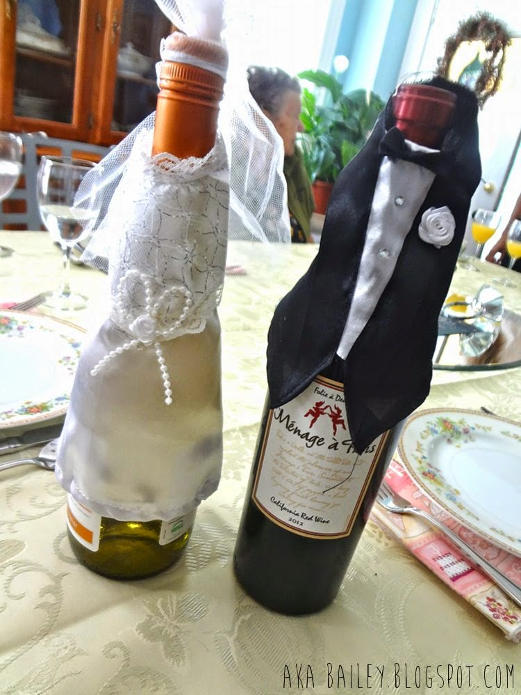 Wine bottles dressed as bride and groom