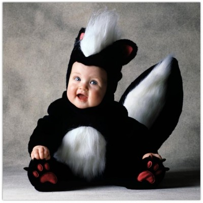 Baby in the costume a skunk