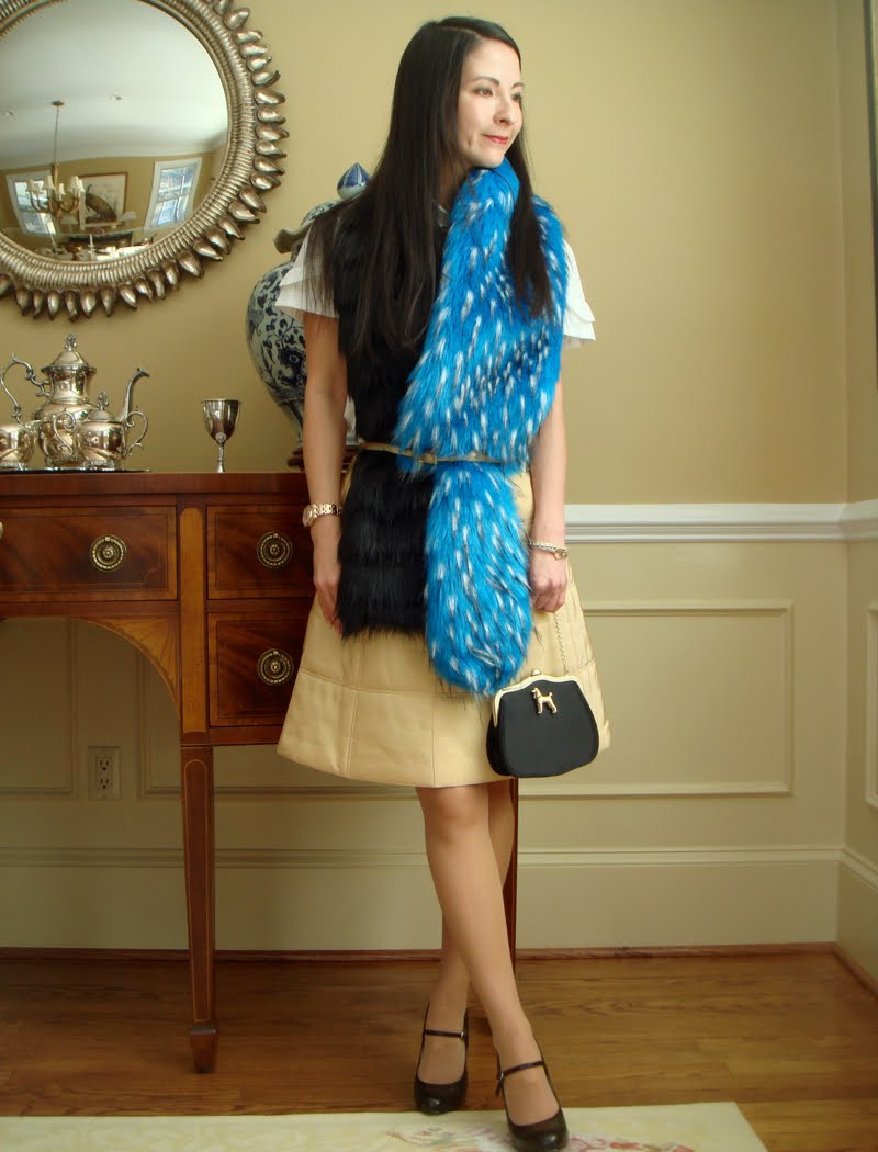 Blue and black fur scarf wrapped with skinny belt on waist.