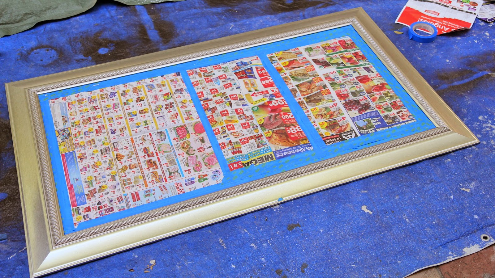 Preparing the frame with newspaper; Transform a Frame from New to Antique; Nora's Nest