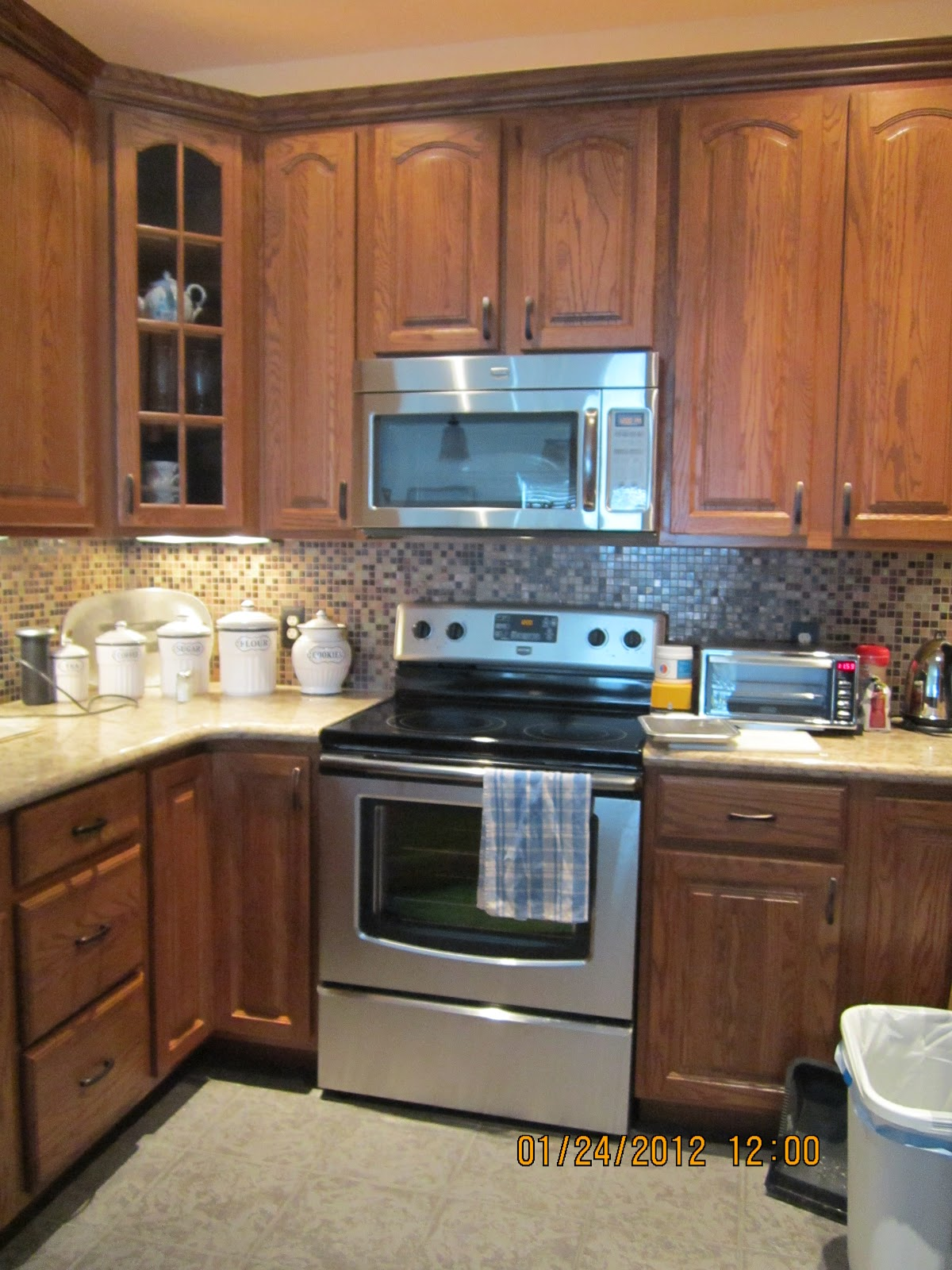 ah ha My exact color cabinet American woodmark oak tawny