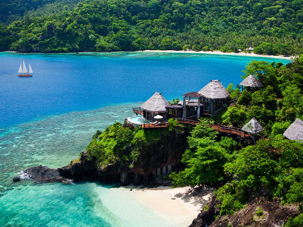 Hoteles singulares laucala resort for Hoteles en islas privadas