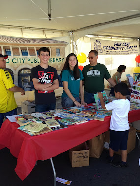 Handing out Books at Community Fairs