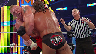 Brock lesnar catching triple h from hand