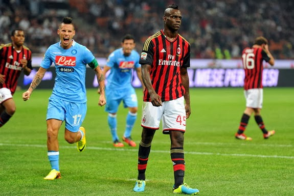 Mario Balotelli appears dejected after missing a penalty for AC Milan against Napoli
