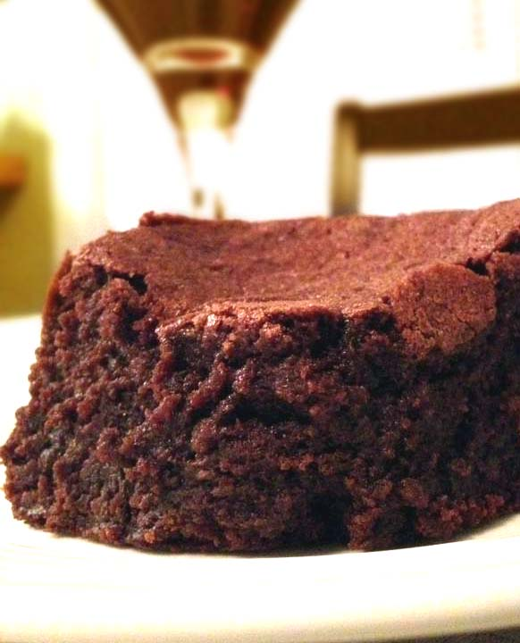 Easy Cocoa Brownies Recipe. It contains sour cream for fudgier-than-usual texture. And it's yummy!