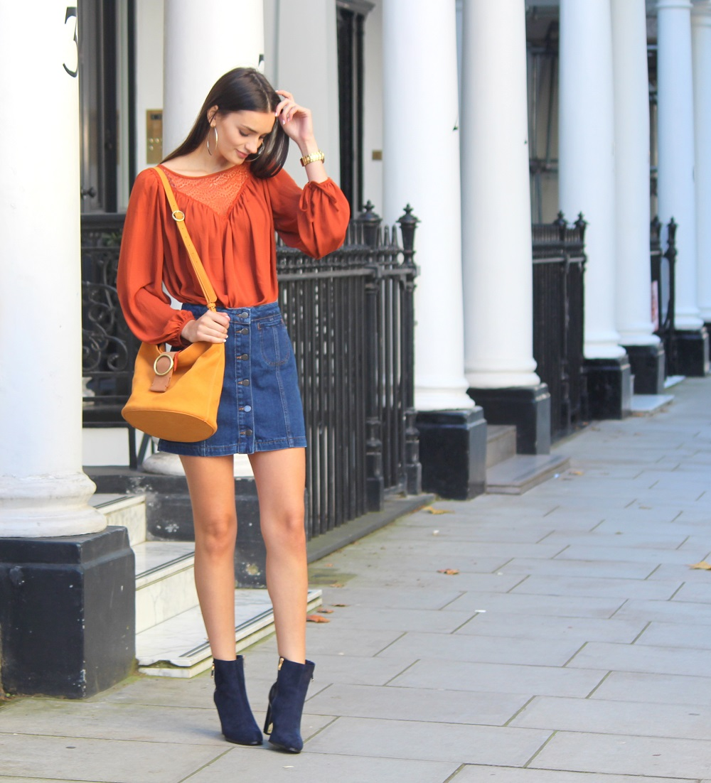 peexo fashion blogger wearing rust boho top and denim a line skirt autumn