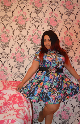 Blogger wearing a Multicoloured Floral Cartoon All Over Print Swing Dress from Yours