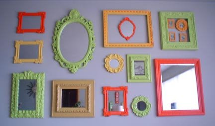 empty antique frames of different shapes and sizes painted in bright colours such a simple way to style up a plain looking room