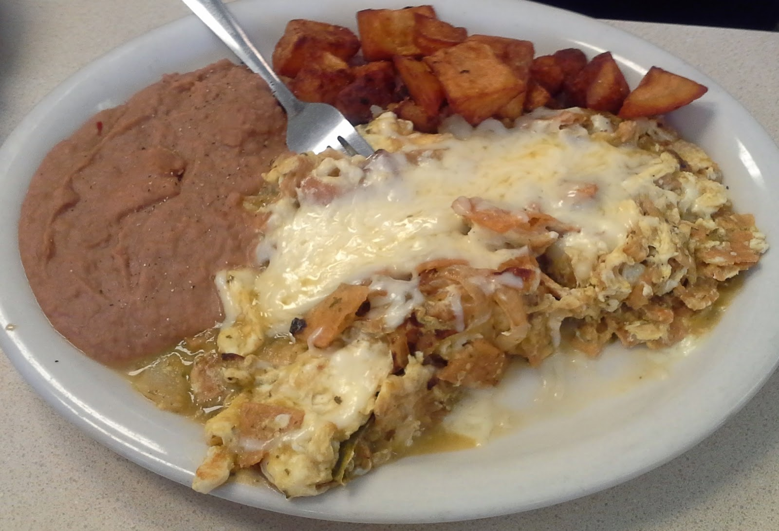 Here's another omelet, sausage, mushroom, and white cheese. This place ...