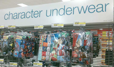 Store display of packaged underwear with large sign above that reads Character Underwear