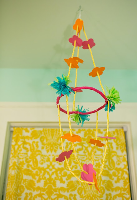 Bright and fun, colorful little girl's room on a budget. DIY chandelier and roman shades.