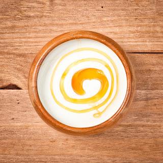 Instead of flavored yogurt, buy plain Greek yogurt and add honey or fresh fruit.
