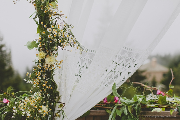 """wildflowers and lace for wedding altar"""