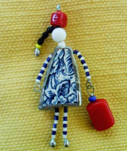 Wearable art created from glass, ceramics, pottery, beads and recycled materials.