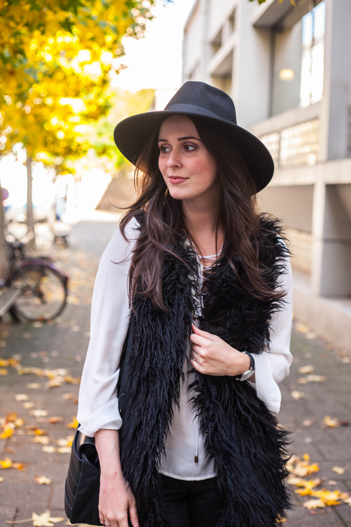 Outfit: wide brim hat, lace up top, shaggy faux fur