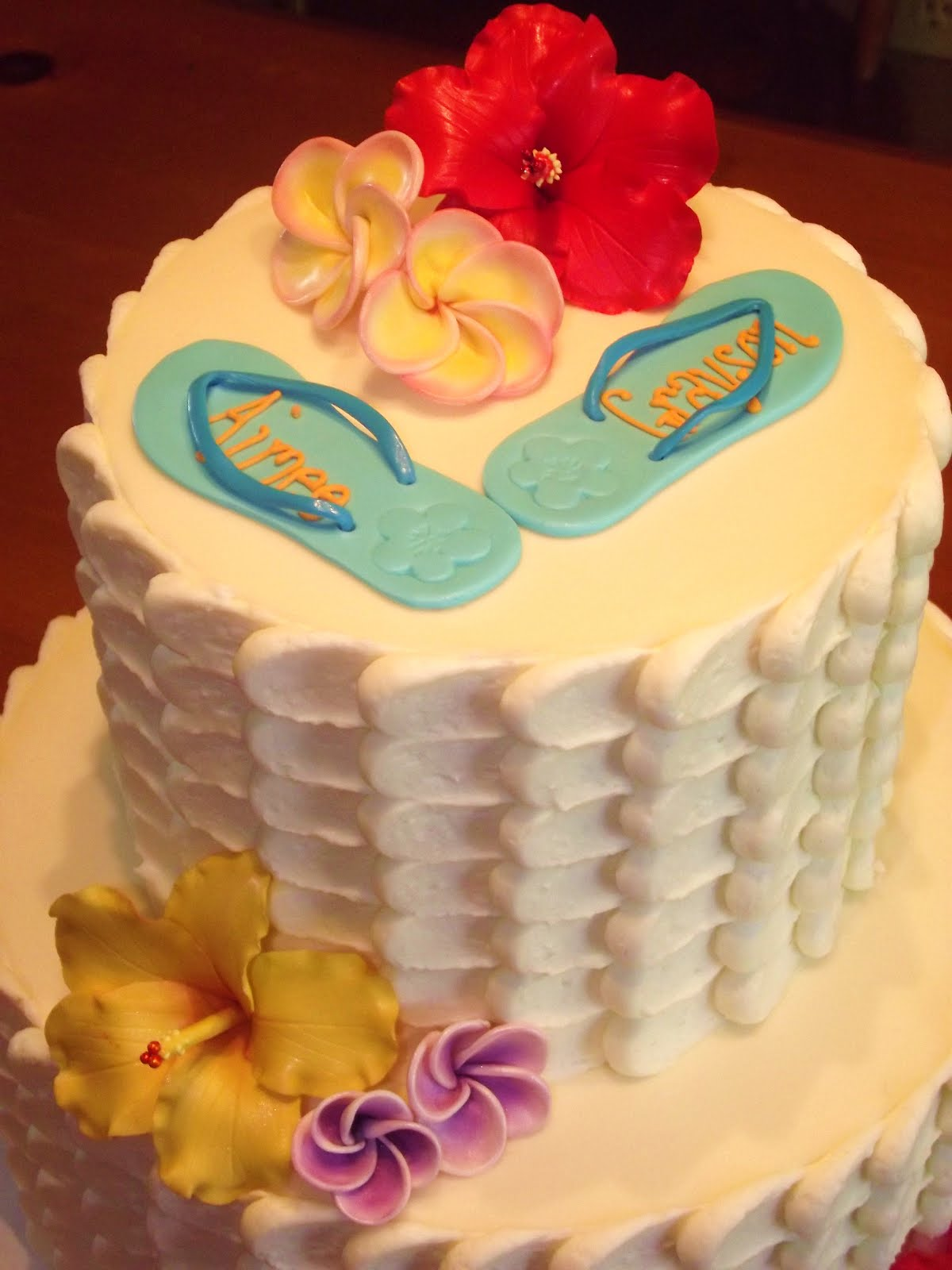 the cake flavor matched the tropical theme of the eventcoconut mango cake with a hinted mango buttercream it smelled so yummy