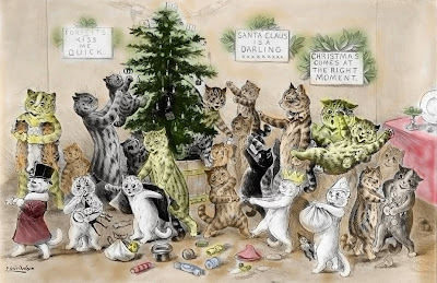 cats decorating a Christmas Tree