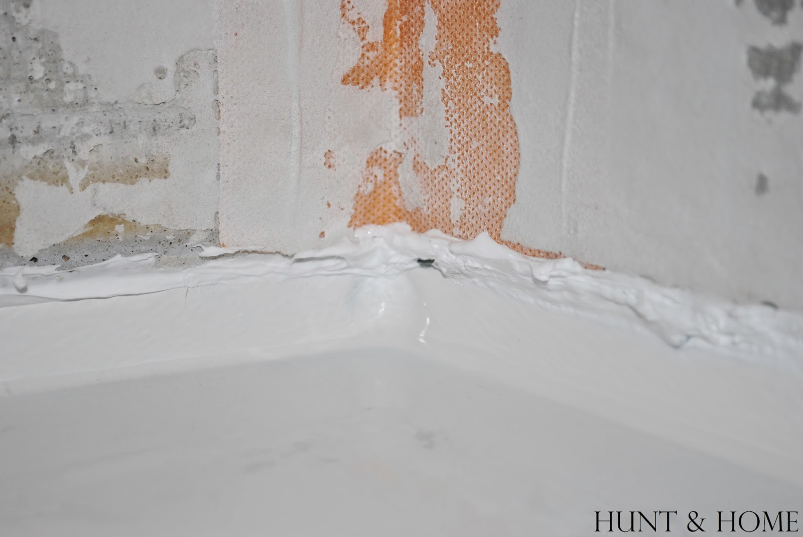 caulk seam between cement board and bathtub