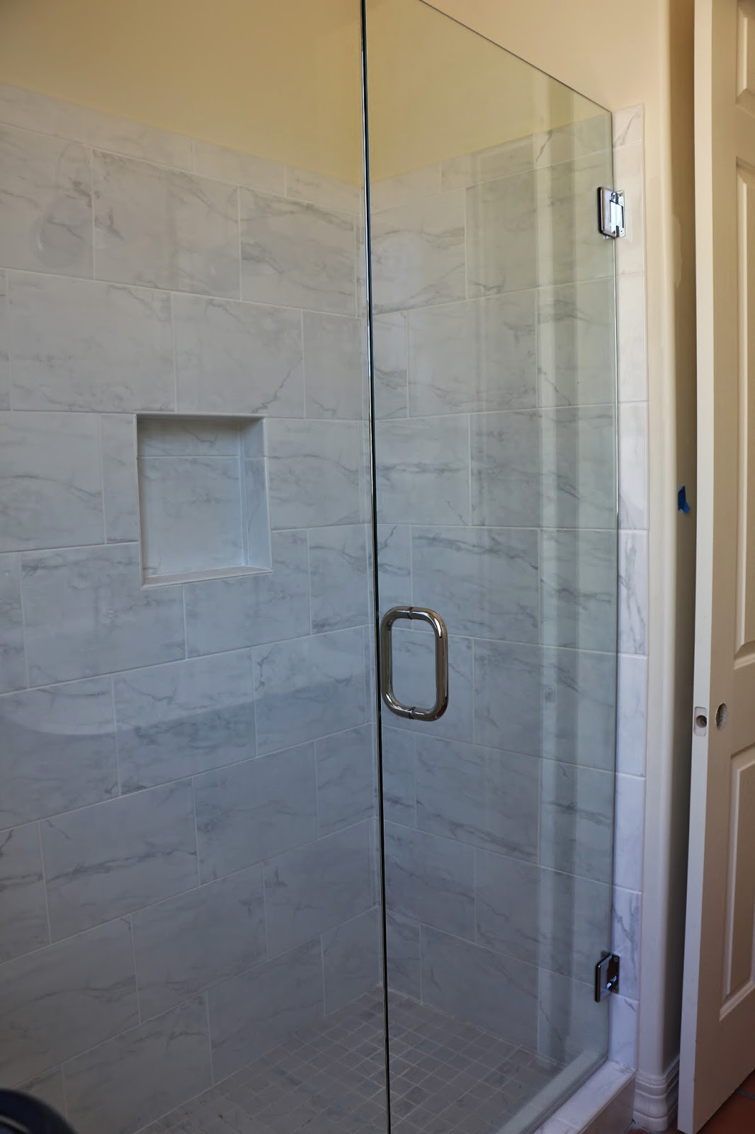 marble shower, frameless glass shower door, marissa cararra tile