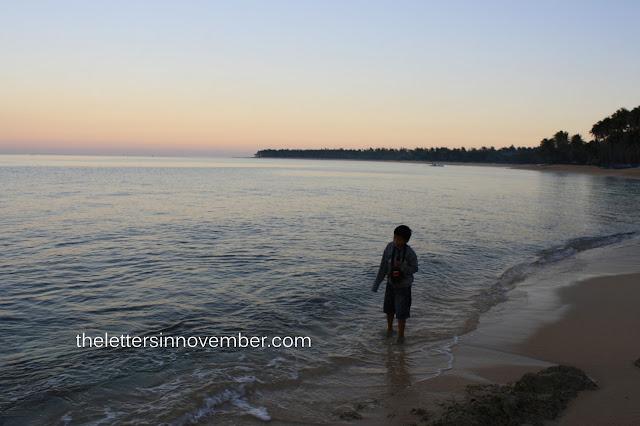 child walking along the beach