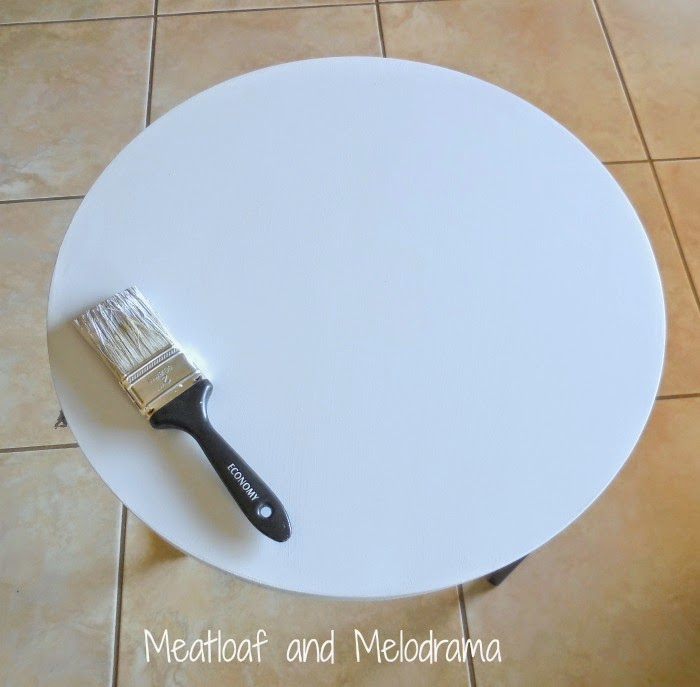 round nesting table painted with spray paint and latex paint