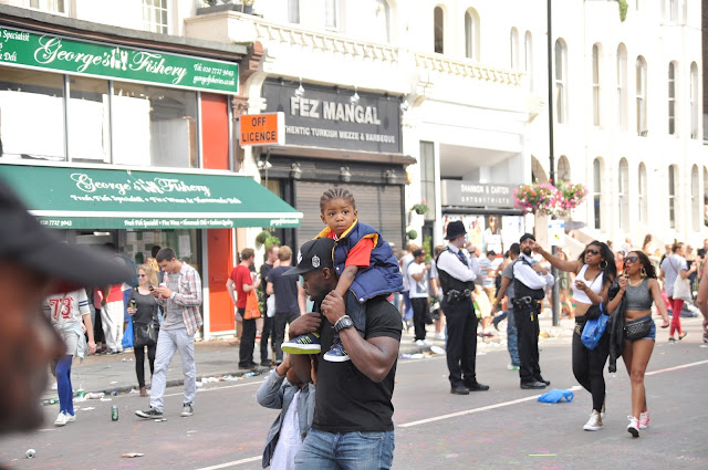 Notting+Hill+Carnival+children+on+piggyback