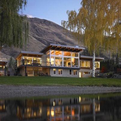 fachada de casa moderna en ambiente rural cerca a lago