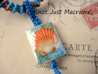 Porcelain seashell pendant with knotted bail