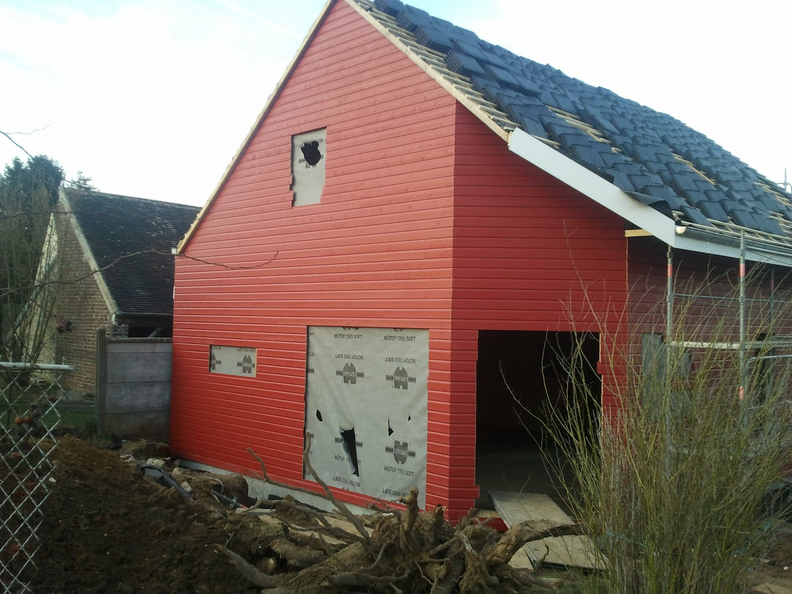 La maison de bois rouge
