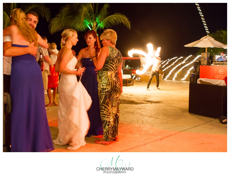 Koh Samui Wedding, fire dancer, guests talking and interacting during fireshow, Beach Republic, Wedding in Thailand