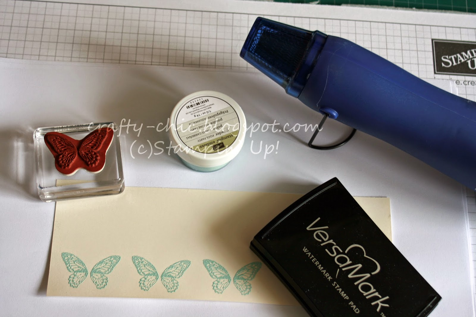 Emboss butterflies with pool party embossing powder