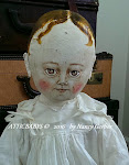 Large, early like, painted cloth doll on Ebay