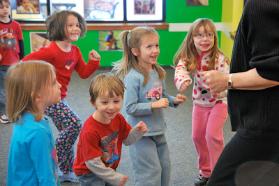 "photo of: Preschool Children Engaged in ""The Carrot Seed"" Dance Story Activity at PreK+K Sharing"