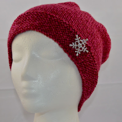 hand knit hat with rhinestone snowflake