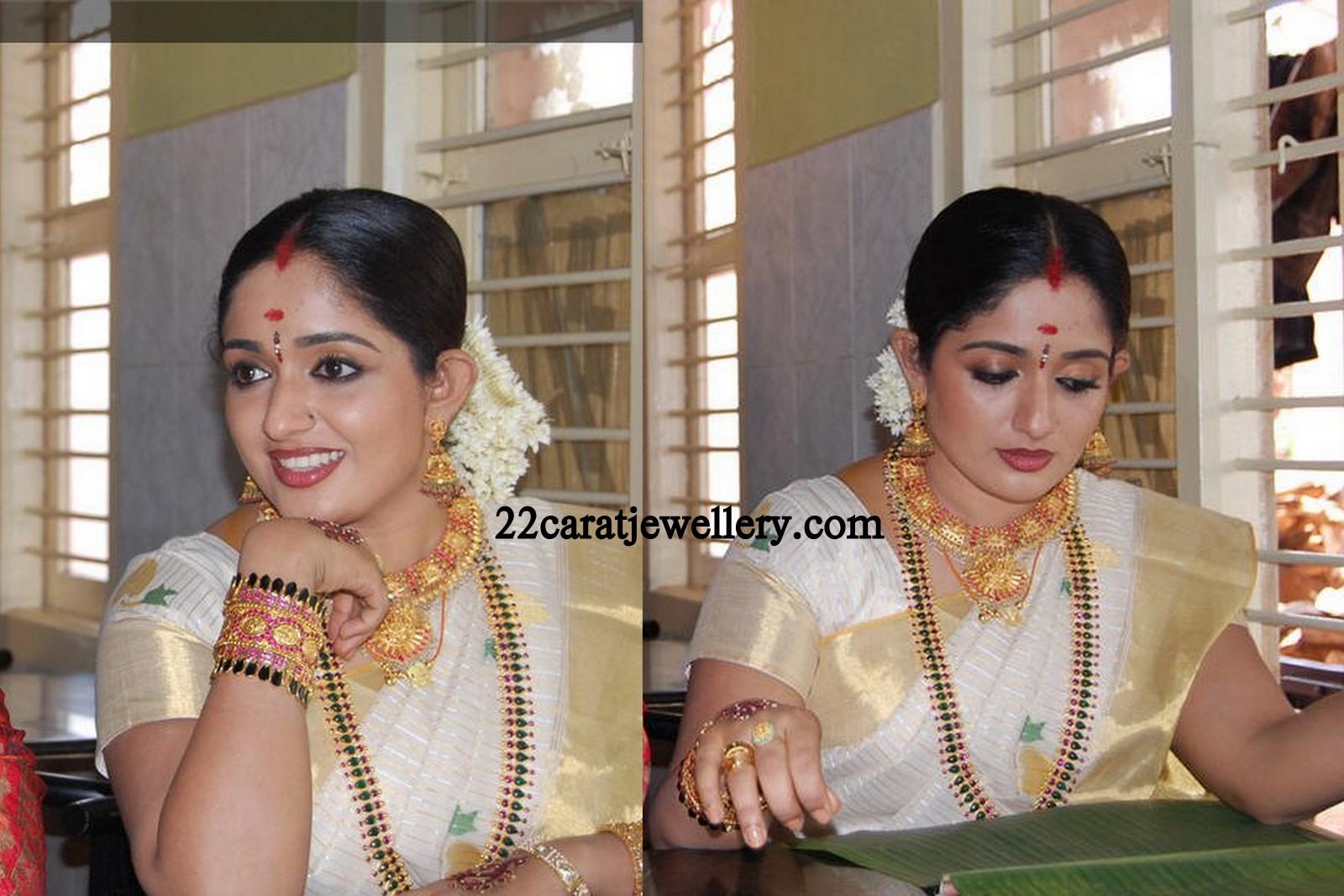 Marriage ornaments - South Indian Actress Kavya Madhavan Spotted With Beautiful 22 Carat Gold Tarditional Mango Mala Studded With Rubys And Emralds Gold Kau Mala Kasula Peru