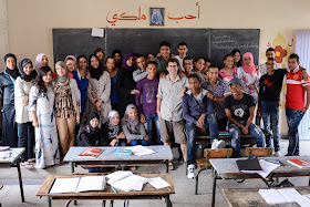 Teaching english abroad to a class of many students in Morocco.