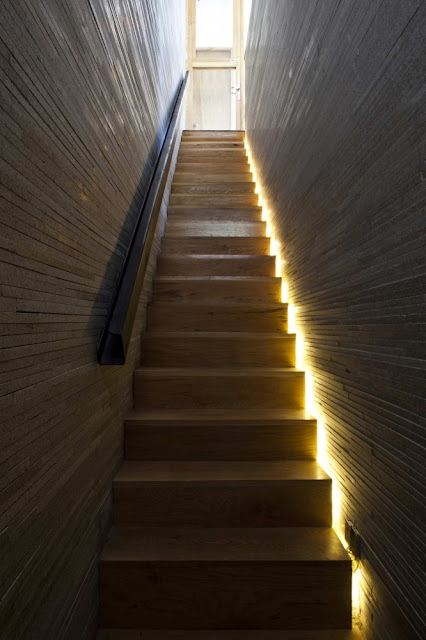 Photo of interiors, wooden stairs with wooden walls