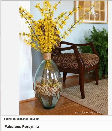 tulips provide a variety of color inside your home but if you have white tulips i love this flower arrangement - Forsythia Arrangements