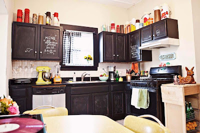 mylittlehousedesign.com vintage thermoses on top of chalkboard black kitchen cabinets