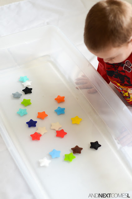 Star themed water sensory bin for kids from And Next Comes L