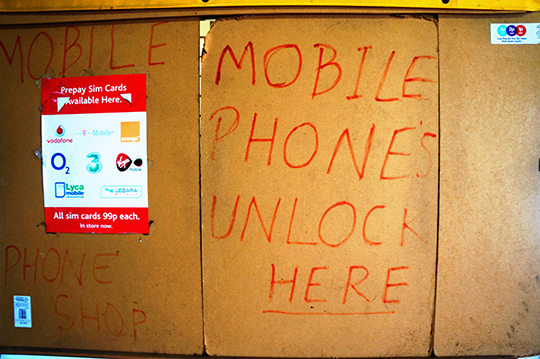 mobile phone shop, sign, urban photography,