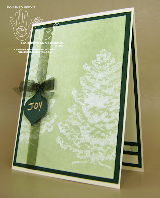 Picture of my green snowy trees Christmas card set at a left angle to show its dimensional elements.