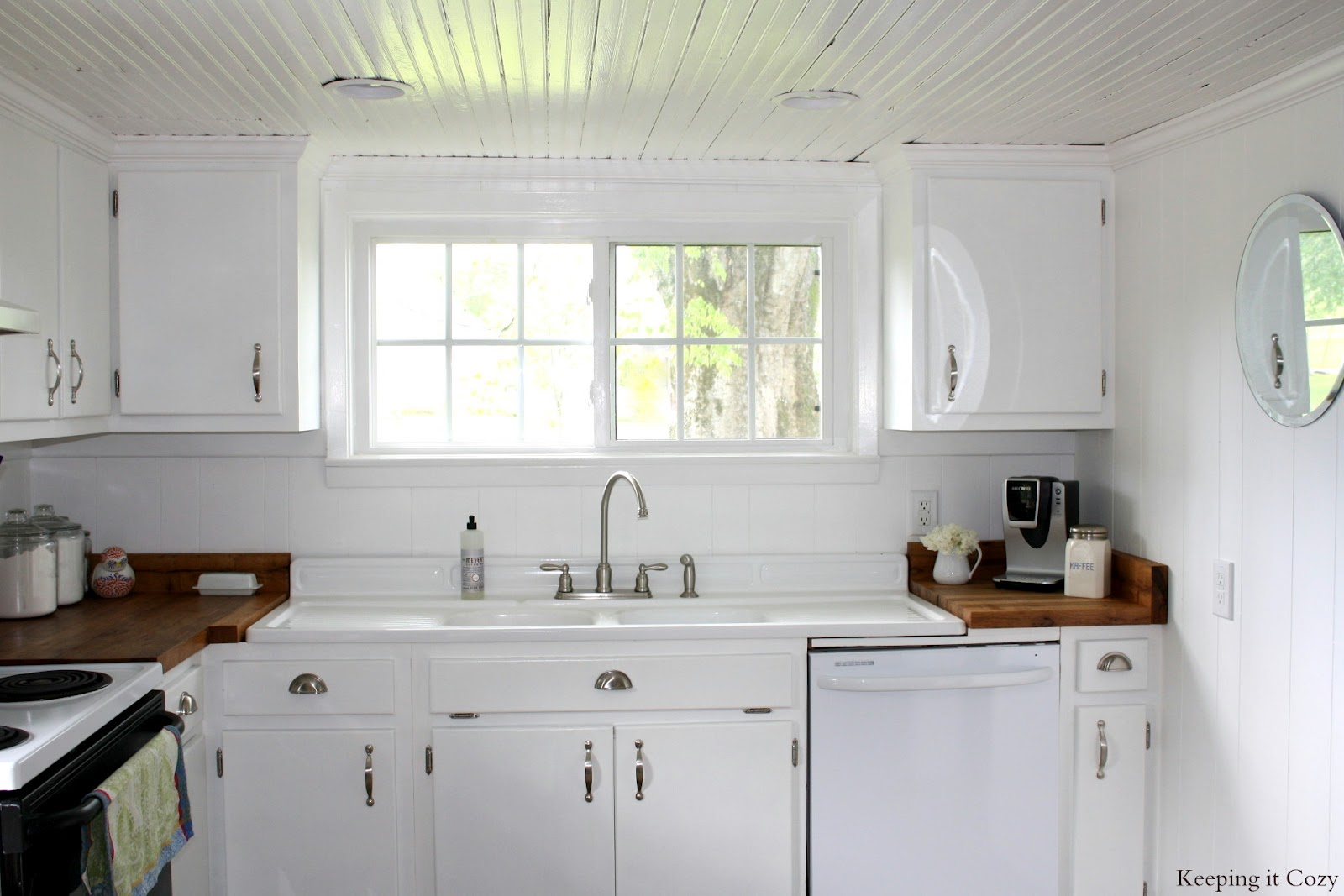 Country kitchen with diy reclaimed wood countertop for Small white country kitchen