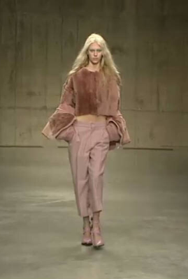 Pink fau fur and tailored trousers