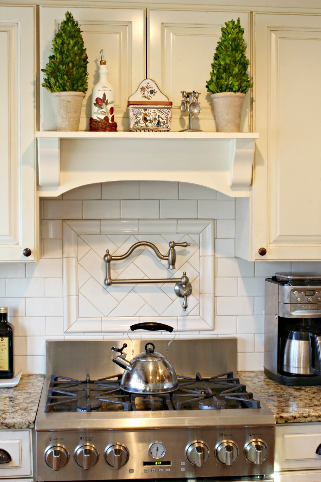 Hand painted salt box from Williams Sonoma in kitchen in DIY mantel hood-www.goldenboysandme.com