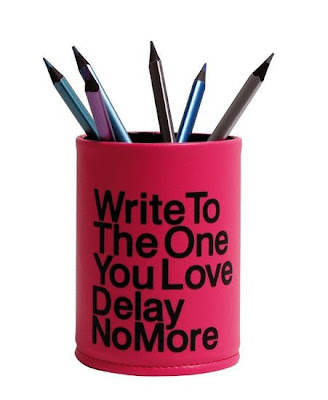 pencil cup, with the words Write to the one you love; delay no more